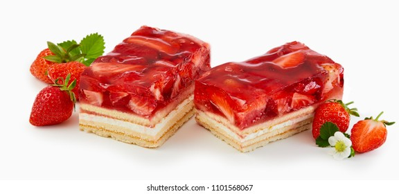 Delicious strawberry dessert with fresh fruit topping on layered cream and pastry in banner format over white for advertising