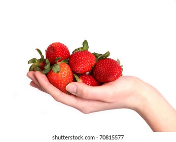A delicious strawberry in a hand