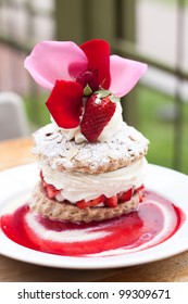 delicious strawberry short cake with beautiful topping on white plate