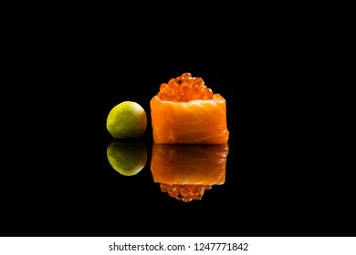 delicious sushi with red caviar on a black background