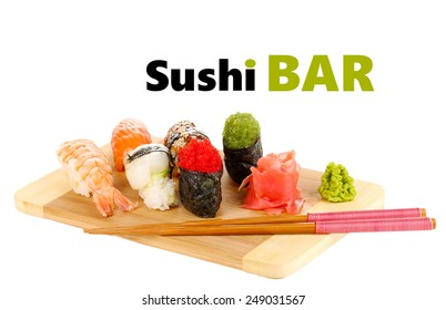 Delicious sushi served on bamboo board isolated on white with space for your text