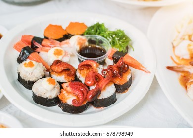 Delicious sushi served on white plate.Popular food in Thailand and around the world. This menu looks appetizing and useful for health.