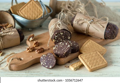 delicious sweet dessert from the grandmother in the form of sausage salami from pastry with nuts and chocolate with cocoa, very tasty and incredibly appetizing