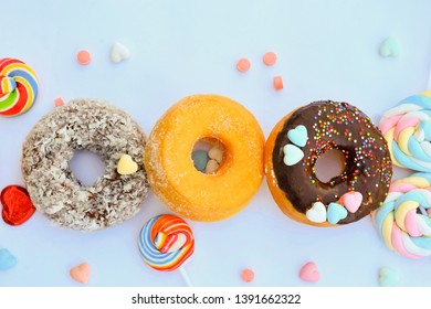 Delicious sweet donuts with garnish and colorful toppings