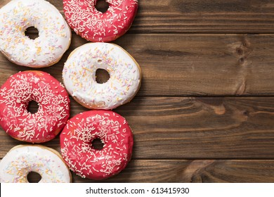 delicious sweet donuts on the  wooden background.