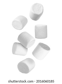 Delicious sweet puffy marshmallows flying on white background