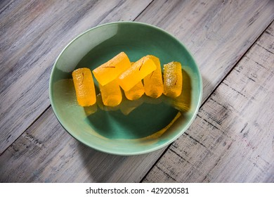 Delicious Sweet Pumpkin Pieces or Dry kesar Petha sweet or pumpkin jelly candy, selective focus