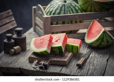 Delicious and sweet watermelon in a old rustic kitchen