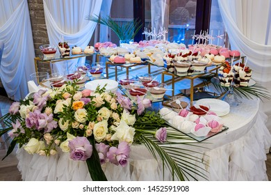 Delicious sweets on candy buffet. Lot of colorful desserts on table.