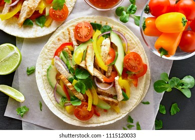 Delicious tacos with chicken meat and vegetables. Top view, flat lay