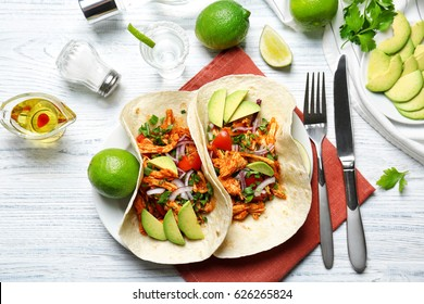 Delicious tacos with tequila lime chicken on plate