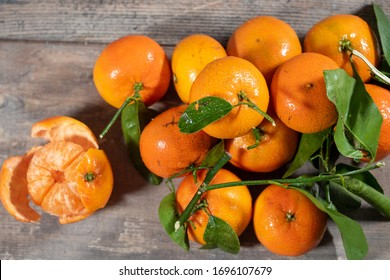 the delicious tangerines on the wooden background