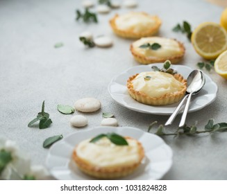 delicious tartelette with lemon curd  on grey table