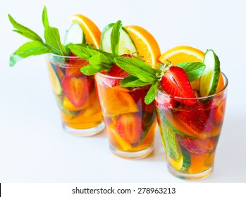 delicious and tasty alcohol cocktail Pimms beautiful white background bar concept fruit salad strawberries amazing