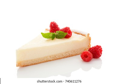 Delicious tasty cheesecake slice with raspberries isolated on white background. Culinary traditional sweet dessert.