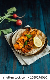 Delicious and tasty chicken kebabs served on the pita bread with lemon wedges. Grilled chicken is the most popular apetizer or meal in Middle East and Asia.