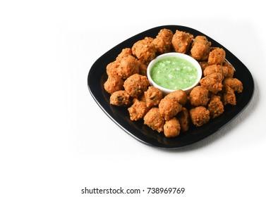 Delicious tasty moong vada and moong pakoda, yummy delicious moong dal bhajiya or bajji or moong Cade or pakora with and green chutney