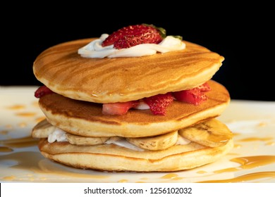 Delicious and tasty pancake with syrup in a dark background