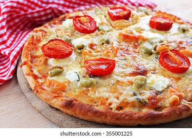Delicious tasty pizza with napkin, closeup