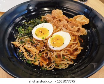 Delicious tasty ramen with pork shabu and boiled egg with Japanese bunching onion on top.