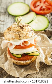 Delicious and tasty sandwich with tomato, lettuce, onion, ...