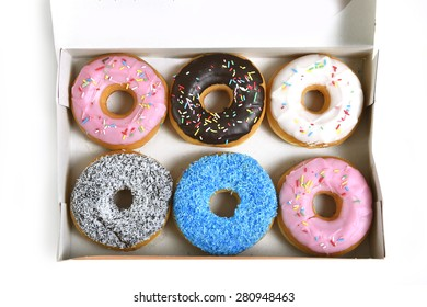 delicious and tempting box full of donuts with different flavors and toppings  in unhealthy nutrition and sugar and sweet cake addiction concept