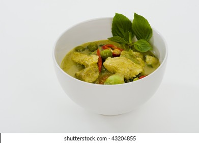 delicious thai food: green curry in a white bowl