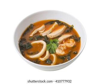 Delicious Thai tom yum soup with seafood and chicken. Isolated on a white background.