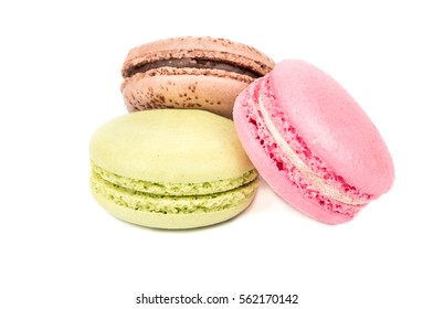 Delicious three multicolored macaroon on a white background