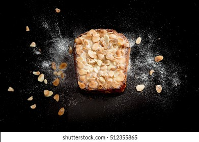 delicious Toast sprinkled with sugar  peas  nut and Baking powder;delicious  Toast on reflection black background shoot from top view