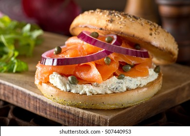 A delicious toasted bagel with smoked salmon, cream cheese, capers, and red onion.