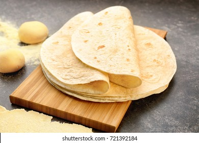 Delicious tortillas on kitchen table