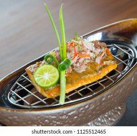 Delicious traditional Balinese fish meal served with shallots and lemon grass