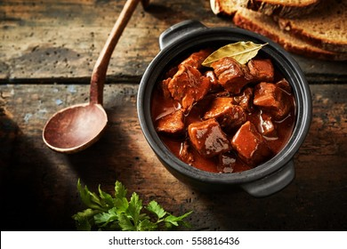 Delicious traditional german cuisine of tasty goulash in a serving size in overhead view