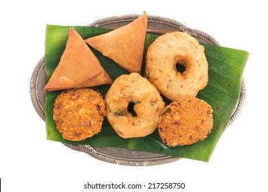 Delicious traditional Indian snack platter isolated on white background.
