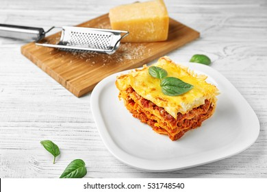 Delicious traditional lasagna on white plate
