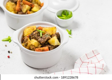 Delicious traditional  roast pork and potatoes in pots. Copy space.