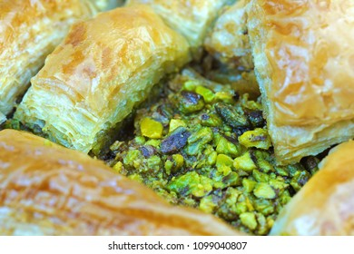 Delicious Turkish baklava with green pistachio nuts , macro shot