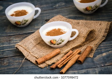 Delicious Turkish hot winter drink, sahlep on wooden background