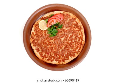 Delicious Turkish pizza lahmacun in clay pan