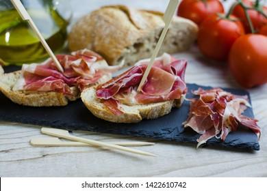 Delicious typical tapa of Serrano ham