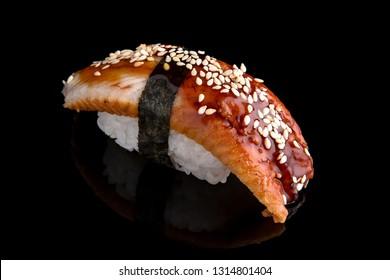 Delicious Unagi Eel Nigiri Sushi (Eel Sushi) on black background. Traditional Japanese cuisine
