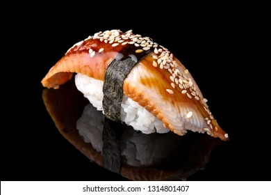 Delicious Unagi Eel Nigiri Sushi (Eel Sushi) on black background. Traditional Japanese cuisine