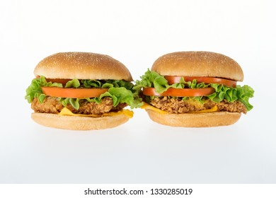 delicious unhealthy chicken burgers isolated on white