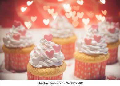 Delicious Valentine's Day Cupcakes With Heart Shape Lights Behind