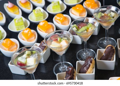 Delicious various colorful dessert cake with fresh fruit on buffet line in restaurant, selective focus