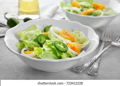 Delicious vegetable salad on table