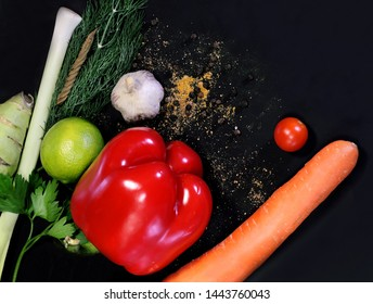 Delicious vegetables on black background still life