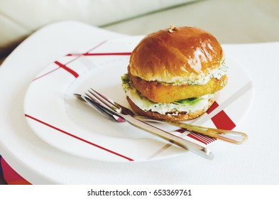 Delicious vegetarian burger served in a plate.