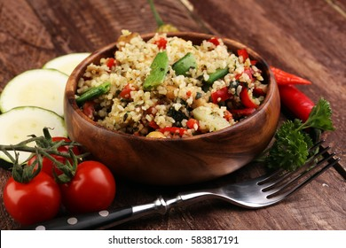 Delicious vegetarian quinoa salad with bell pepper, cucumber